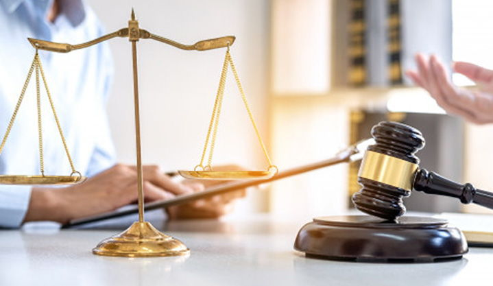 A person holding pad at table and law aid on table
